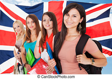 Group Of Happy College Students Standing In Front Of British...