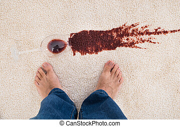 Person Standing Near Wine Spilled On Carpet - Close-up Of A...