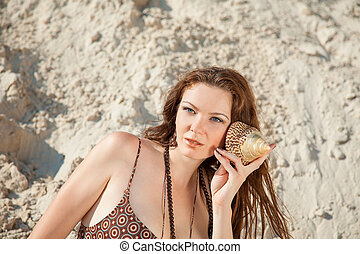 girl - Attractive girl on the beach with shell