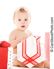 baby boy with gifts - picture of baby boy with gifts over...