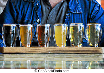 glasses of Beers - glasses of the different Beers on wood...