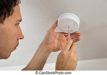 Electrician Repairing Fire Sensor - Close-up Of Electrician...