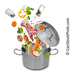 Fresh vegetables falling into stainless steel pot isolated...