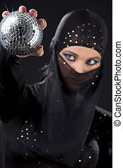 ninja - party dancer in ninja dress with disco ball focus on...