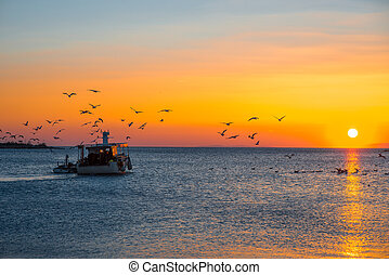 Fising boat on sunset - Fising boat going fishing with...