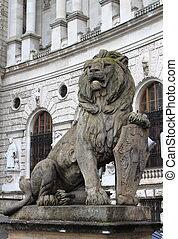 Lion statue with shield in Vienna Hofburg, Austria