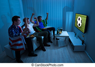 Friends Cheering While Enjoying Match - Group Of Friends...