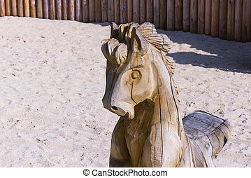 wooden horse statue