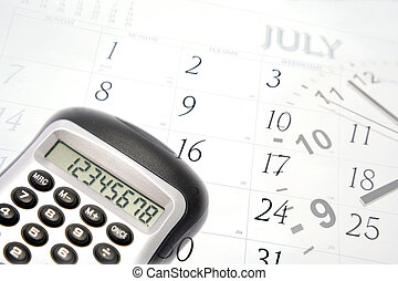 Business objects - Calculator, clock hands and July calendar