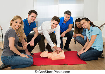 Resuscitation Training Using First-aid Dummy - Group Of...