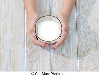 hand holding glass of milk