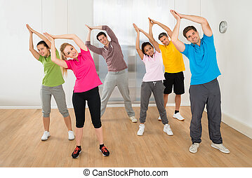 Group Of People Practicing Yoga - Group Of Happy Multiethnic...