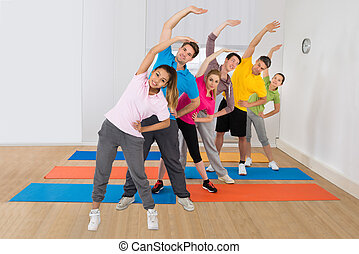 People Doing Fitness Exercise - Sporty People Doing Fitness...