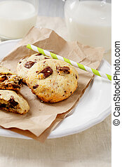 Cookies with a glass of milk on paper