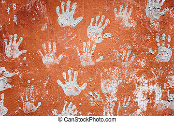 Concrete red wall with prints of hands
