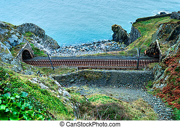 Scenic Railroad in Ireland - Railtrack entering tunnels on...