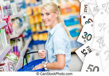 Girl at the shop choosing shampoo