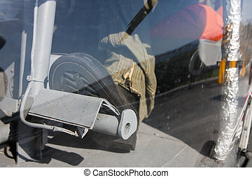 Rudder Pedals - A pilot at the controls of a helicopter,...