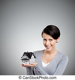 Holding small toy house