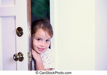 Young girl peeking into new house