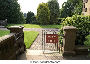 gate with way out sign - way out or exit sign