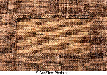 Frame of burlap, lies on a background of burlap,can be used...