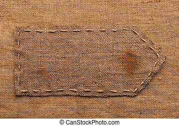 Arrow of burlap, lies on a background of burlap,can be used...