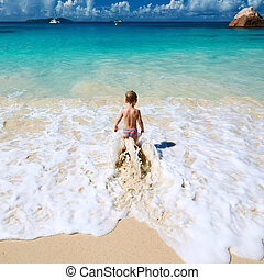 Two year old boy playing on beach - Two year old baby boy...