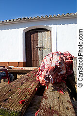 Pig head - Pieces of pig over wooden table. Traditional home...