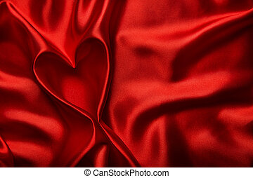 Heart Shape, Red Silk Cloth Background, Fabric folds as...