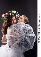 Homosexual girlfriends posing in wedding costumes - Charming...