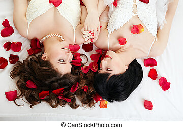 Gay marriage. Top view of smiling beautiful brides - Gay...