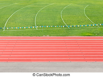 Side view of multi lane athletic running track and field -...