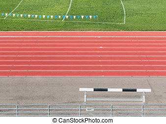 Side view of multi lane athletic running track and field...