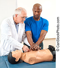 Adult Student Practicing CPR - Doctor helping an adult...