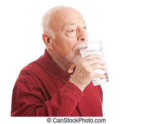 Thirst Quenching Filtered Water - Senior man quenches his...