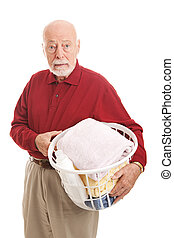 Confused Senior Man with Laundry - Confused senior man does...