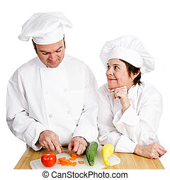 Chefs - Observing Preperation - One chef observes another's...