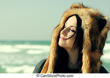 Beautiful girl relaxing outdoor at winter beach