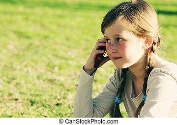 Cute girl with mobile phone