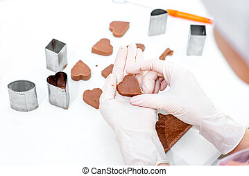 Making chocolate candy - Young woman making and decorating...