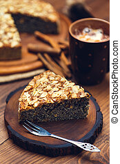Homemade pie with poppy seeds and almond flakes on rustic...