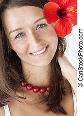 smiling brunette with red flower