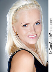 young and fresh blonde smiling, studio shot
