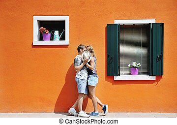 couple in a sunny day in Burano, Venice, Italy - couple in a...