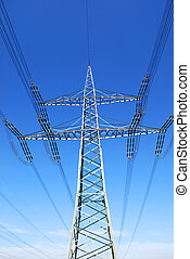 pylon in front of deep blue sky and some clouds