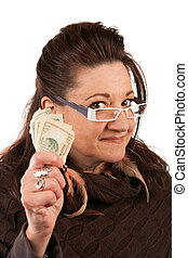 Woman Holding Cash - Brunette woman holding up some money in...