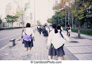 Group of yong studen walking to school