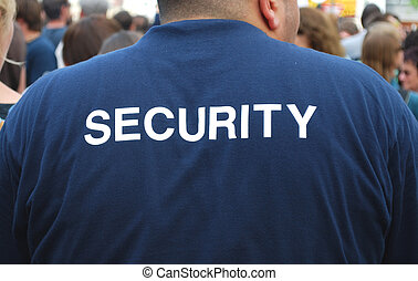 back of a security guard watching a crowd of people