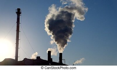 Chimney with smog backlit footage